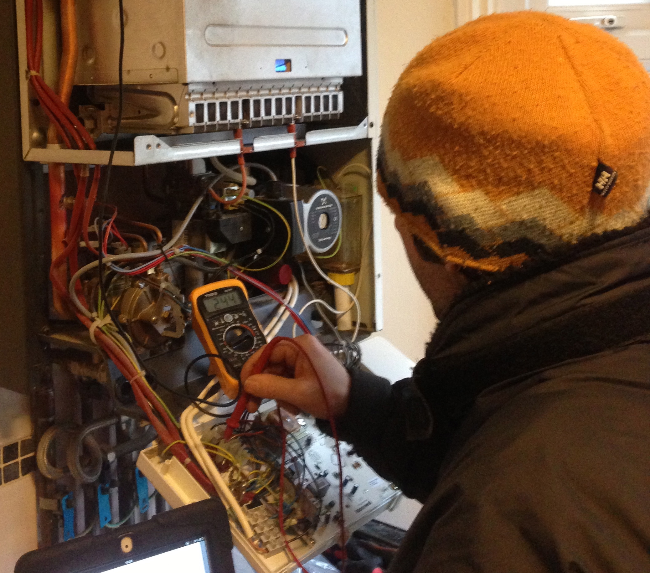 Gas Engineer carry out fault finding and testing on a combination boiler.