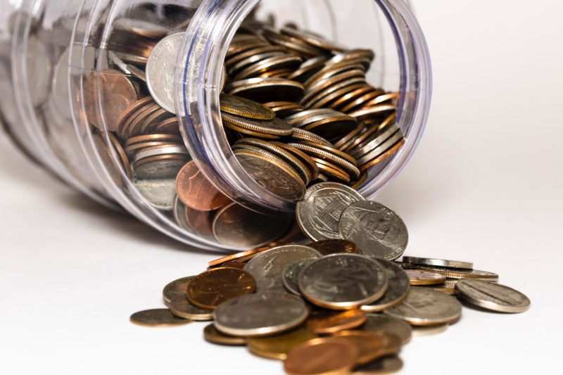 A jar of money that represents how our 24 hr plumbers in Walthamstow saves you money.